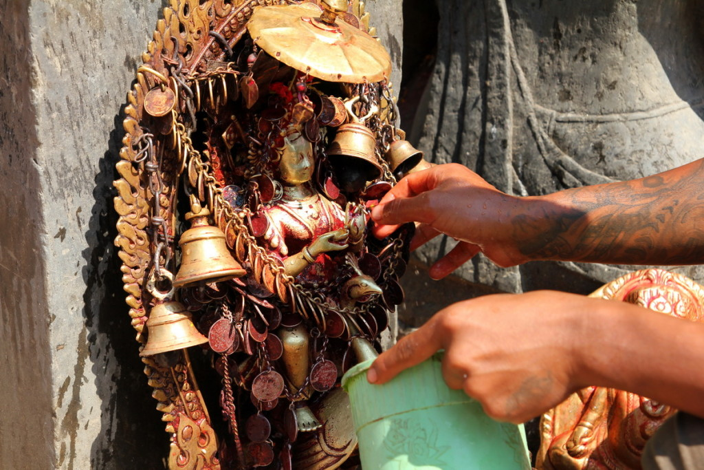 Balkumari Shrine being washed down before being digitally preserved