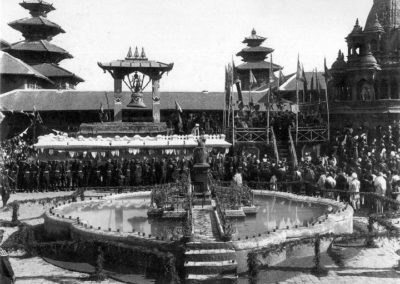 A festive occasion at Patan Durbar Square in 1910s. The pond is dedicated to the Prime Minister Chandra Shumshere's first queen. The statue in the middle of it has been transferred to the Patan Museumca 1905