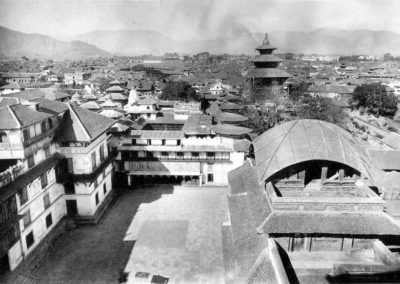 A view from atop Basantapur Durbar over Nasal Chowk towards the north, in the 1920s. The Kirtipur tower in the foreground was built in the 18th century; its roof is in the Bengali style. Source: Images of the Century