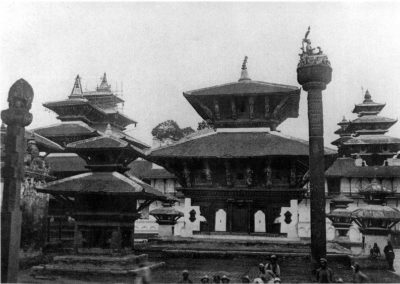The Jagannath temple (dedicated to Vishnu 1563 AD) in Kathmandu Durbar Square. The pillar on the foreground surmounted by King Pratap Malla(Pic - 1920 AD)Source: Images of the Century
