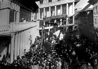 One of the earliest photos of Gaddhi Baithak during Indra jatra taken during 1900sAfter the earth quake, much part of the palace was lost and Juddha Sadak or New road took its place.Gaddi Baithak on the left side of the picture is still the old structu