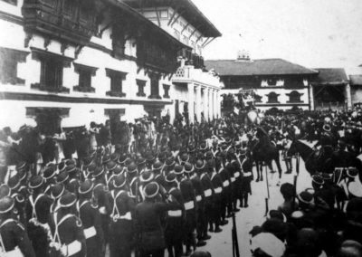 Parade before World war one in Kathamandu Durbar Square. Here, the currently non existant part and the old form of Gaddhi Baithak can be seen