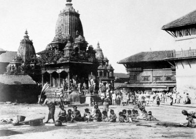 Patan Durbar Square from SoutheastIn background-Bhasmeshwara TemplePhotograph by: Kurt Boeck