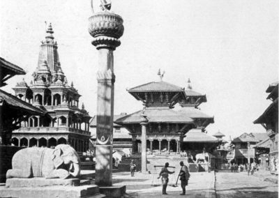 Patan Durbar Square from the south, in the early 1920s.The statue in the foreground is that of Yog Narendra Malla, grandson of Siddhi Narsingh Malla