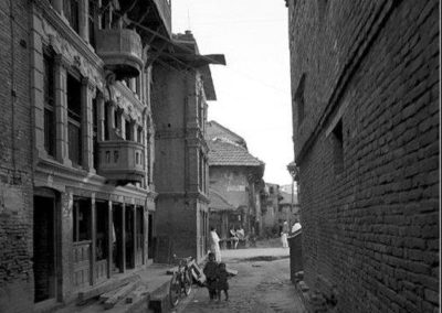 Towards Chikamungal from Om BahalOn the background is the street leading to BhimsenthanProbably in 70ies Contributed by: Sudhir Shrestha